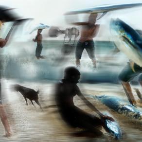 pescatori o Surfisti al Isola del Sal. pero'C'è una sirena in mare.