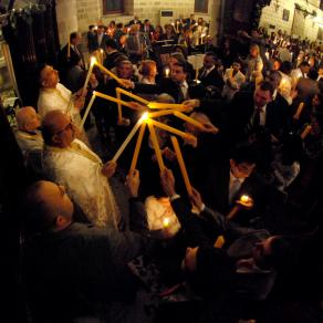 Candle burning  ceremony with the holy fire